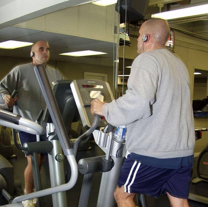 man exercising on an elliptical trainer