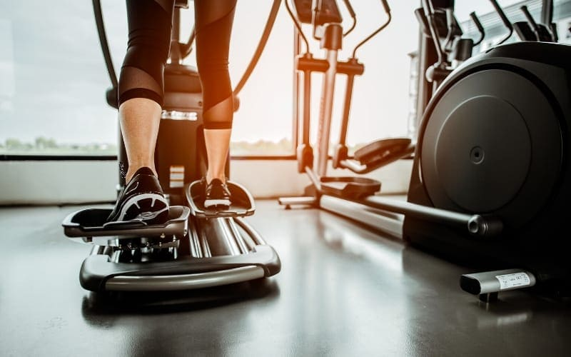 Woman exercising on an elliptical machine